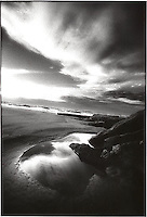 Clouds reflected in beach puddle<br />