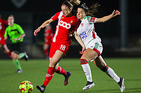 Charlotte Cranshoff (18 Standard) and Luna Vanzeir (10 OHL) battle for the ball during a female soccer game between Oud Heverlee Leuven and Standard Femina De Liege on the 10th matchday of the 2020 - 2021 season of Belgian Womens Super League , sunday 20 th of December 2020  in Heverlee , Belgium . PHOTO SPORTPIX.BE | SPP | SEVIL OKTEM