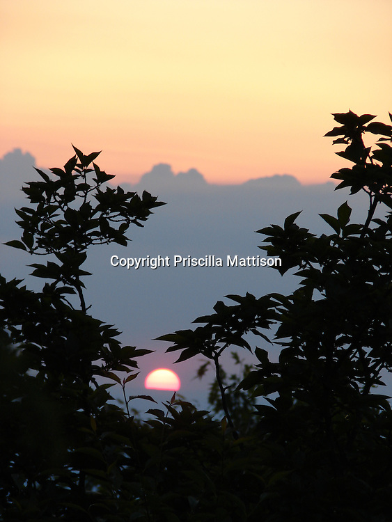 Shenandoah National Park, Virginia - June 11, 2007:  The sun slips behind a ridge and in front of clouds in the Blue Ridge Mountains.