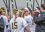 25 April 2015: University of Vermont Catamount Midfielder Courtney Cole, a Freshman from York, Maine, provides encouragement during a game timeout against the University of New Hampshire Wildcats at Virtue Field in Burlington, Vermont. The Lady Catamounts defeated the Lady Wildcats 12-10 in the final game of the season, advancing to the America East playoffs. Mandatory Credit: Ed Wolfstein Photo *** RAW (NEF) Image File Available ***