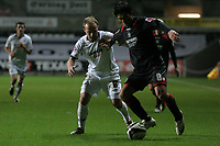 Pictured: Thomas Butler of Swansea (L)  against Miguel Mostto of Barnsley (R) <br /> Re: Coca Cola Championship, Swansea City FC v Barnsley at the Liberty Stadium. Swansea, south Wales, Tuesday 09 December 2008.<br /> Picture by D Legakis Photography / Athena Picture Agency, Swansea 07815441513