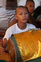 Cambodia, Angkor Wat.  Young Boy Playing a Drum in a Cambodian Orchestra.
