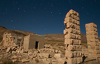 Moonlit ruins of the Overbury Bank building in the ghost town of Rhyolite, Nevada, a mining boomtown that, at its peak between 1905 and 1912, had a population of 5,000 to 10,000.
