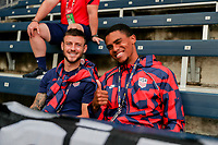 KANSAS CITY, KS - JULY 15: Paul Arriola #7 and Reggie Cannon #20 of the United States before a game between Martinique and USMNT at Children's Mercy Park on July 15, 2021 in Kansas City, Kansas.