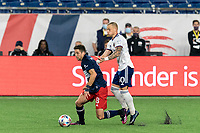 FOXBOROUGH, MA - APRIL 24: Matt Polster #8 of New England Revolution dribbles as Erik Sorga #50 of D.C. United defends during a game between D.C. United and New England Revolution at Gillette Stadium on April 24, 2021 in Foxborough, Massachusetts.