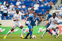 El Salvador midfielder Richard Menjivar (6) is marked by Trinidad and Tobago midfielder Khaleem Hyland (8) and midfielder Keon Daniel (19) during a CONCACAF Gold Cup group B match at Red Bull Arena in Harrison, NJ, on July 8, 2013.