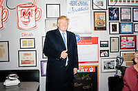 Republican presidential candidate Donald Trump poses for a portrait after speaking to reporters at the Red Arrow Diner in Manchester, New Hampshire.