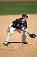 West Virginia State Yellow Jackets third baseman Brett Christian (18) on defense against the Catawba Indians at Newman Park on February 9, 2020 in Salisbury, North Carolina. The Indians defeated the Yellow Jackets 15-9 in game one of a doubleheader.  (Brian Westerholt/Four Seam Images)
