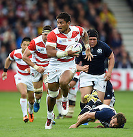 Amanaki Mafi of Japan takes on the Scotland defence. Rugby World Cup Pool B match between Scotland and Japan on September 23, 2015 at Kingsholm Stadium in Gloucester, England. Photo by: Patrick Khachfe / Stewart Communications