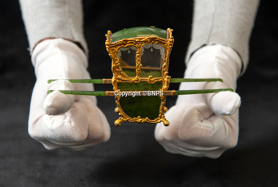 BNPS.co.uk (01202 558833)<br /> Pic: PhilYeomans/BNPS<br /> <br /> In from the cold - Romanov treasure rediscovered in the Cotswolds.<br /> <br /> In from the cold - £500,000 Romanov treasure is hot property at Cotswold auction.<br /> <br /> An exquisite Faberge antique believed to have been made for the Russian Royal family over 100 years ago sold yesterday for a whopping £500,000...over 5 times it's estimate.<br /> <br /> The model of a sedan chair by the iconic Russian jewellers was one of the state treasures seized and sold off by the communist regime following the Russian Revolution.<br /> <br /> It was first sold at high-end Anglo-Russia antique dealers Wartski in London in 1929, where it was bought by a K.W Woollcombe-Boyce for only £75.<br /> <br /> The ornate item, crafted from Jadeite, gold, rock crystal and mother of pearl, has remained in the family ever since and is now being sold by a direct descendant of Mr Woollcombe-Boyce.<br /> <br /> Experts from the Cotswold Auction Company gave the small Russian antique a pre-sale estimate of only £100,000, but always anticipated it could go for much more than that.