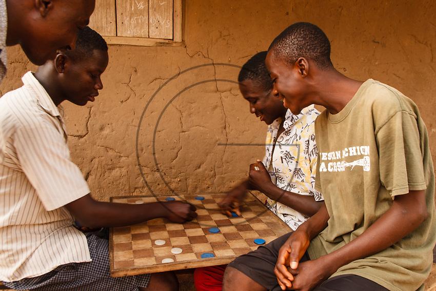 Africa, Ghana,boys play checkers