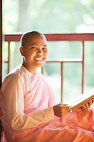 A young nun studies and prays at Zayar Theingi  convent in Sagaing, near Mandaly, Myanmar