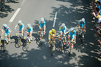 Team Astana rolls out of Evry for the last stage of the 101th Tour.<br /> As winners of the yellow jersey they pose for the traditional 'riding champagne shot' for the photographers.<br /> <br /> 2014 Tour de France<br /> stage 20: ITT Bergerac - Périgueux (54km)