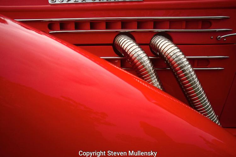 Detail of a vintage supercharged Excalibur car.