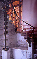 Staircase in Maison Horta designed by architect Victor Horta for his own residence and museum, 1898-1891. Note the bottom of the stairs and his clever iron column supporting the staircase.
