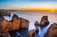 Beautiful sunrise over the famous, colorful Ponta da Piedade cliffs and the Atlantic Ocean, in Algarve region, Portugal Europe