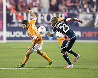 Houston Dynamo forward Will Bruin (12) and New England Revolution defender Jose Goncalves (23) turn to intercept a high ball.  The New England Revolution played to a 1-1 draw against the Houston Dynamo during a Major League Soccer (MLS) match at Gillette Stadium in Foxborough, MA on September 28, 2013.