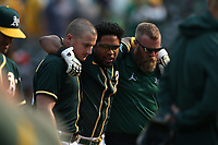 OAKLAND, CA - SEPTEMBER 25:  Elvis Andrus #17 of the Oakland Athletics is carried off the field by teammate Matt Chapman #26  and trainer Jeff Collins after getting hurt scoring the winning run in the bottom of the 9th inning on a double by Starling Marte #2 to beat the Houston Astros 2-1 during the game at the Oakland Coliseum on Saturday, September 25, 2021 in Oakland, California. (Photo by Brad Mangin)