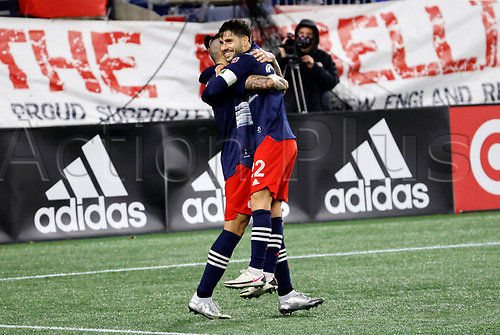 20th November 2020; Foxborough, MA, USA;  New England Revolution forward Carles Gil hugs New England Revolution forward Gustavo Bou after his stoppage time winner during the MLS Cup Play-In game between the New England Revolution and the Montreal Impact