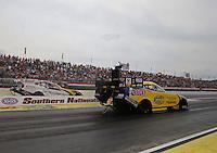May 11, 2013; Commerce, GA, USA: NHRA funny car driver Matt Hagan (near lane) races alongside Tim Wilkerson during the Southern Nationals at Atlanta Dragway. Mandatory Credit: Mark J. Rebilas-