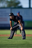 Umpire Shin Koishizawa during a Pioneer League game against the Great Falls Voyagers at Centene Stadium at Legion Park on August 19, 2019 in Great Falls, Montana. Missoula defeated Great Falls 4-1 in the first game of a doubleheader. Games were moved from Missoula after Ogren Park at Allegiance Field, the Osprey's home field, was ruled unplayable. (Zachary Lucy/Four Seam Images)