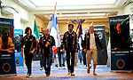 The teams march into the Imperial Ballroom with their respective flags.