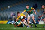 Conal O hAinifein, Clare, in action against Dara Moynihan, Kerry, during the Munster Football Championship game between Kerry and Clare at Fitzgerald Stadium, Killarney on Saturday.