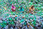 Sorting through a mountain of plastic bottles by Joy Saha