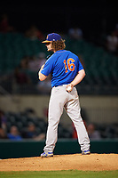 Midland RockHounds starting pitcher Grant Holmes (16) looks in for the sign during a game against the Arkansas Travelers on May 25, 2017 at Dickey-Stephens Park in Little Rock, Arkansas.  Midland defeated Arkansas 8-1.  (Mike Janes/Four Seam Images)