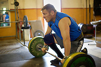 Neil Elliott lifts weights at his gym in Dumbarton. He competes in over 40 Highland Games and heavyweight events across the world throughout the summer.