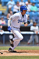 Asheville Tourists designated hitter Grant Lavigne (34) runs to first base during a game against the Delmarva Shorebirds at McCormick Field on May 5, 2019 in Asheville, North Carolina. The Shorebirds defeated the Tourists 10-9. (Tony Farlow/Four Seam Images)