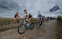 Sep Vanmarcke (BEL/LottoNL-Jumbo) leads the peloton ahead of Tony Martin (DEU/Etixx-Quickstep) over the cobbled sector of Artres (1200m)<br /> <br /> stage 4: Seraing (BEL) - Cambrai (FR) <br /> 2015 Tour de France