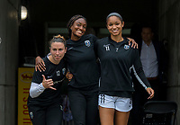 CARY, NC - OCTOBER 20: Morgan Andrews #12, Ifeoma Onumonu #25 and Darian Jenkins #11 of Reign FC walk onto the field during a game between Reign FC and North Carolina Courage at Sahlen's Stadium at WakeMed Soccer Park on October 20, 2019 in Cary, North Carolina.