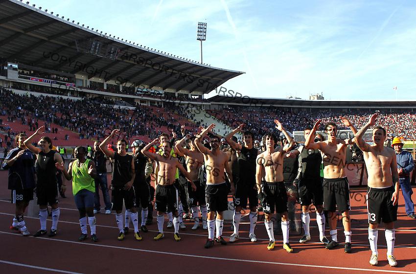 Partizan Belgrade players celebrate victory over Red Star, during the Serbian League soccer match in Belgrade, Serbia, Saturday, October  24, 2010. (Srdjan Stevanovic/Starsportphoto.com)