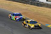 #20: Erik Jones, Joe Gibbs Racing, Toyota Camry DeWalt and #18: Kyle Busch, Joe Gibbs Racing, Toyota Camry M&M's Caramel