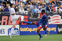 Santino Quaranta (20) of the United States (USA) and Mones Chery (14) of Haiti (HAI). The United States and Haiti played to a 2-2 tie during a CONCACAF Gold Cup Group B group stage match at Gillette Stadium in Foxborough, MA, on July 11, 2009. .