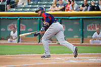 Stefan Romero (11) of the Tacoma Rainiers at bat against the Salt Lake Bees in Pacific Coast League action at Smith's Ballpark on July 9, 2014 in Salt Lake City, Utah.  (Stephen Smith/Four Seam Images)