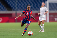 SAITAMA, JAPAN - JULY 24: Crystal Dunn #2 of the USWNT passes the ball during a game between New Zealand and USWNT at Saitama Stadium on July 24, 2021 in Saitama, Japan.