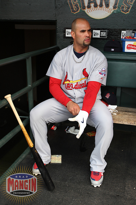 SAN FRANCISCO - MAY 30:  Albert Pujols of the St. Louis Cardinals gets ready in the dugout before the game against the San Francisco Giants at AT&T Park in San Francisco, California on Saturday, May 30, 2009.  The Cardinals defeated the Giants 6-2.  Photo by Brad Mangin