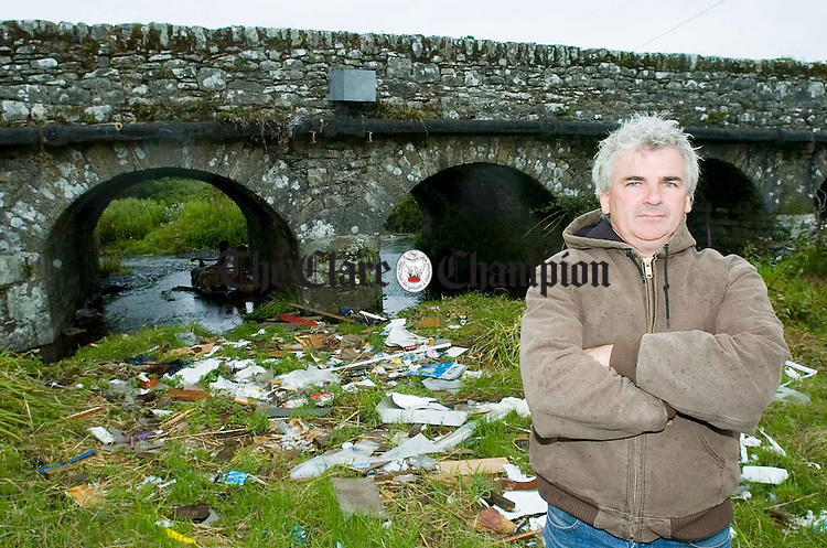 Robert Shannon,Tourist  Youth Hostel owner, with some of the rubbish at Roadford Bridge, Doolin. Photograph by John Kelly.