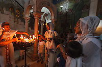 Israel, Jerusalem, church of holy Sepulcher, ethiopian coptic women light candles at the Holy sepulcher