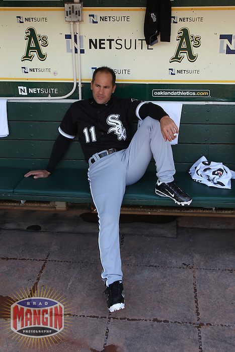 OAKLAND, CA - MAY 15:  Omar Vizquel #11 of the Chicago White Sox gets ready in the dugout before the game against the Oakland Athletics at the Oakland-Alameda County Coliseum on May 15, 2011 in Oakland, California. Photo by Brad Mangin