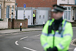 """Portsmouth 1 Southampton 1, 18/12/2012. Fratton Park, Championship. A police officer on patrol at the end of a closed-off street outside Fratton Park stadium before Portsmouth take on local rivals Southampton in a Championship fixture. Around 3000 away fans were taken directly to the game in a fleet of buses in a police operation known as the """"coach bubble"""" to avoid the possibility of disorder between rival fans. The match ended in a one-all draw watched by a near capacity crowd of 19,879. Photo by Colin McPherson."""