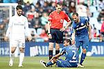 Getafe's Alvaro Pereira injured in presence of Mehdi Lacen (r), Real Madrid's Isco Alarcon (l) and the referee Gonzalez Gonzalez during La Liga match. April 16,2016. (ALTERPHOTOS/Acero)