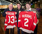 """Dec. 11, 2015; Bob Nanovic, left, and Jim McAdams hold personalized Detroit Red Wings jerseys as they pose for photos with George Bowman, secretary of the Detroit Red Wings Alumni Association, after the NHL Alumni game at the Compton Family Ice Arena. The game was part of the Nanovic Institute for European Studies event """"Elite Athletes and the Cold War."""" (Photo by Matt Cashore/University of Notre Dame)"""