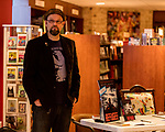 "July 26, 2017. Raleigh, North Carolina.<br /> <br /> Author Alan Gratz spoke about and signed his new book ""Refugee"" at Quail Ridge Books. The young adult fiction novel contrasts the stories of three refugees from different time periods, a Jewish boy in 1930's Germany , a Cuban girl in 1994 and a Syrian boy in 2015."