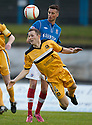 Dumbarton's Martin McNiff heads clear from Cowdenbeath's Lewis Coult ...