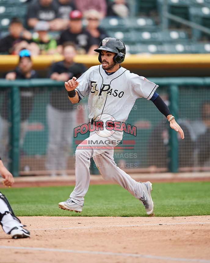 Carlos Asuaje (2) of the El Paso Chihuahuas scores against the Salt Lake Bees in Pacific Coast League action at Smith's Ballpark on April 30, 2017 in Salt Lake City, Utah. El Paso defeated Salt Lake 12-3. This was Game 2 of a double-header originally scheduled on April 28, 2017.  (Stephen Smith/Four Seam Images)