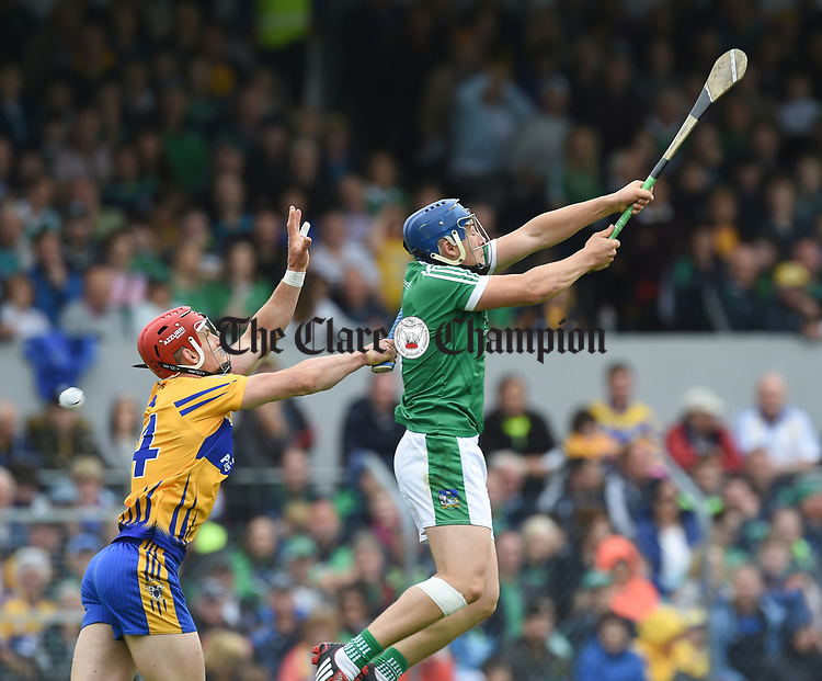 John Conlon of Clare in action against Mike Casey of Limerick during their Munster championship game in Ennis. Photograph by John Kelly.
