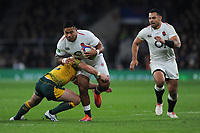Manu Tuilagi of England is tackled by Tolu Latu of Australia during the Quilter International match between England and Australia at Twickenham Stadium on Saturday 24th November 2018 (Photo by Rob Munro/Stewart Communications)